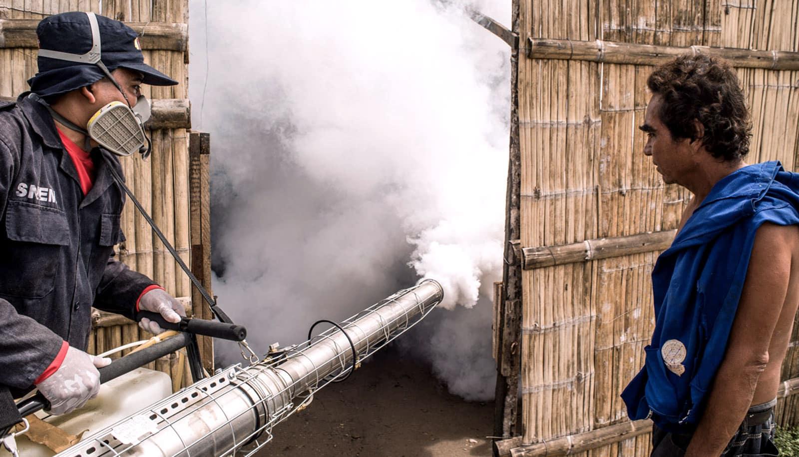 spraying insecticide in Ecuador