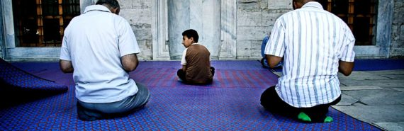 praying men and child in mosque