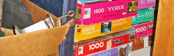 clutter: board games and box in closet