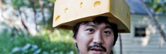man wears cheese hat
