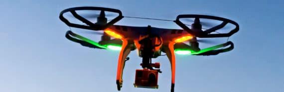 drone quadcopter against blue sky