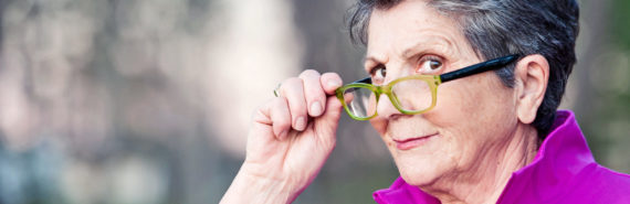 woman looks over glasses knowingly