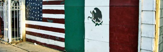 Mexican and American flags on a garage