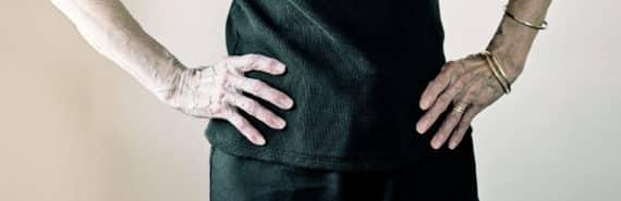senior woman hands on hips