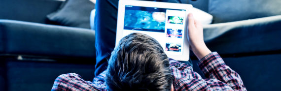 teen using iPad on the floor