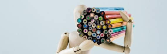 wooden model holding color pencils