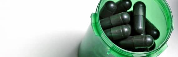 black pills in green bottle