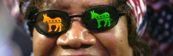 woman wears democratic party sunglasses
