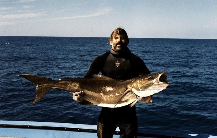 fisherman holds fish
