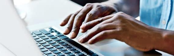 hands of man online shopping