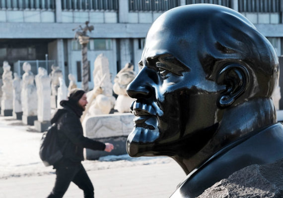 Lenin statue head and pedestrian