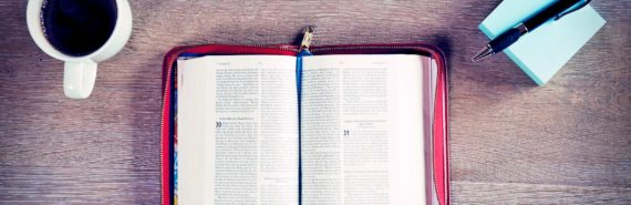 bible on table with coffee