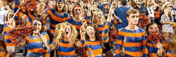 football fans in orange and blue bodypaint