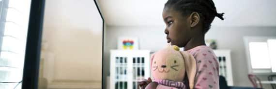 girl watching TV up close