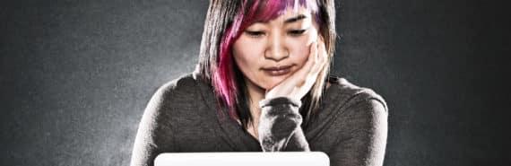 woman uses laptop