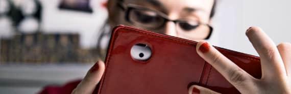 reading social media on phone