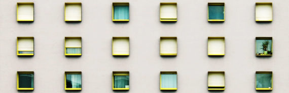 tiny teal windows in pink wall