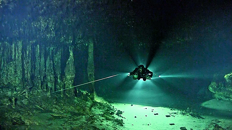 diver in cave finding methane microbe