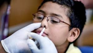flumist goes up boy's nose