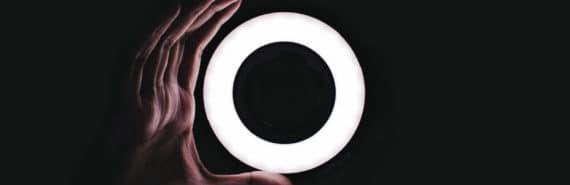 hand holds O on black