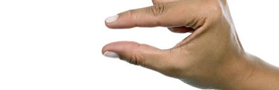 """""""little bit"""" hand gesture on white"""