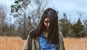 woman walks in field
