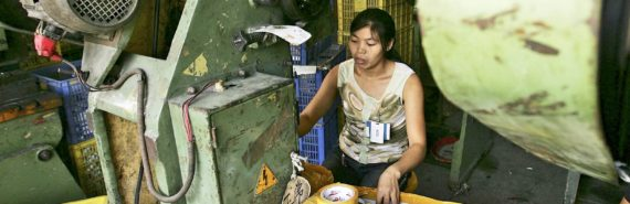 woman uses machine in Chinese factory