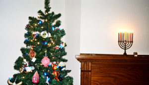 xmas tree and menorah on mantle - interfaith holidays