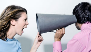 yelling into megaphone (confronting racist speech concept)