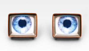 big blue eyes on two tv screens
