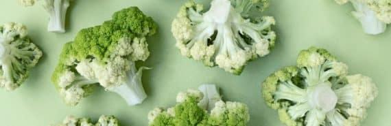 cauliflower on green background (healthy foods concept)
