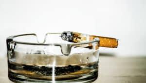 cigarette on glass ashtray