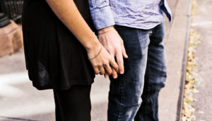 couple holding hands (discrimination and health effects for partners)