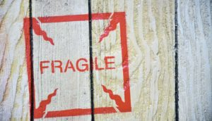 fragile stamp on wood crate (Fragile X Syndrome concept)