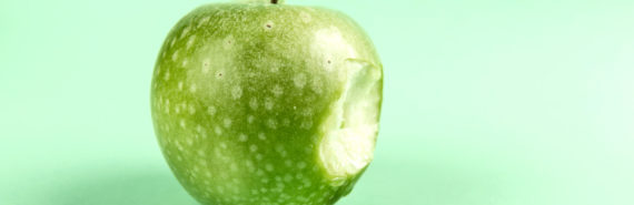 bite out of green apple