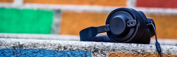 headphones on a colorful brick wall (hearing concept)