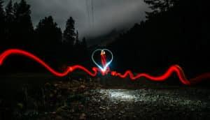 heart-shaped light in dark forest