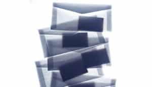 cards inside translucent envelopes
