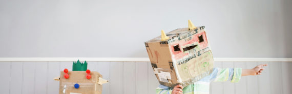 cardboard robot and kid in robot costume hat