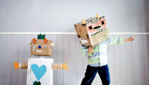 cardboard robot and child in robot costume hat