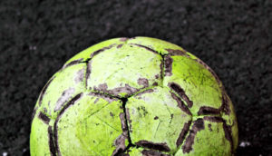 yellow, patchy soccer ball