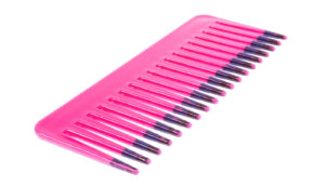 pink comb on white