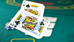 Two kings tossed down while playing poker (artificial intelligence, poker, games concept)