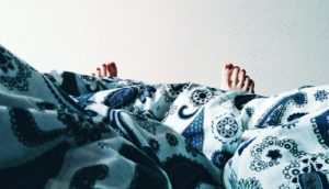 woman's toes under blanket
