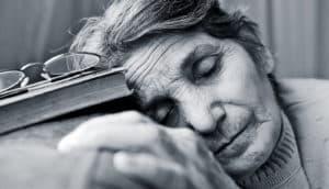 sleeping older woman (sleep + memories concept)