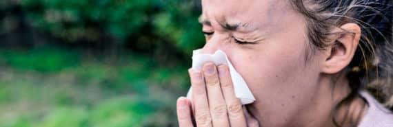 sneezing woman (virus infection concept)