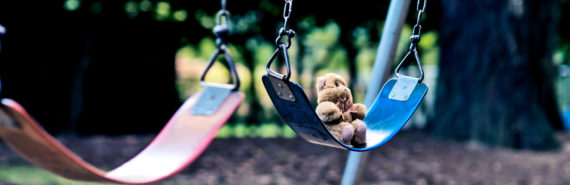 teddy bear on swing alone (child neglect concept)