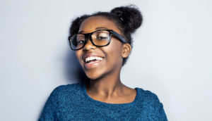 black teen girl smiling (positive racial identity concept)