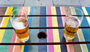 two beers on a table (parents, teens, + alcohol concept)