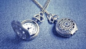 two pocket watches on blue - time travel
